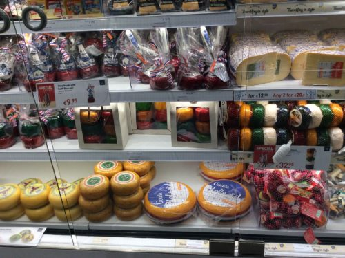 Rounds of Dutch cheese in a supermarket fridge